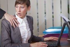Molestation by work. Sexual harassment - surprised woman looking at the hand on her shoulder royalty free stock photos
