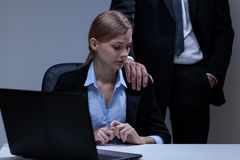 Molestation at workplace Royalty Free Stock Images