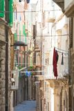 Molfetta, Apulia - Narrowness lifestyle in the old alleyways of stock photo