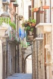 Molfetta, Apulia - Old balconies and a historical archway in an stock images