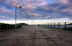 Molhe e nuvens Fotografia de Stock