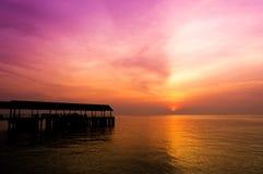 Molhe e por do sol Fotos de Stock Royalty Free