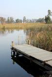 Molhe em um lago imagem de stock royalty free