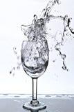 Molhe o respingo em um vidro Imagem de Stock