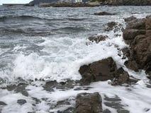 Molhe a vinda na rocha Foto de Stock