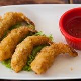 Molho e utensílios fritados quatro de camarão. Imagens de Stock Royalty Free