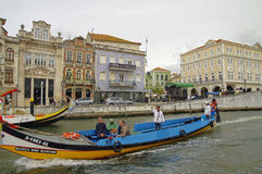 The Moliceiro boat voyage along the canal of Aveiro City, Portugal Stock Images