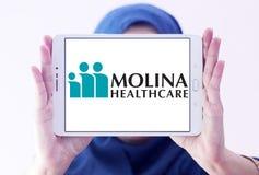 Molina Healthcare company. Logo of Molina Healthcare on samsung tablet holded by arab muslim woman. Molina Healthcare is a managed care company. The company Royalty Free Stock Photo