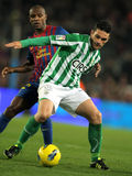 Molina vies with Abidal. Jorge Molina(R) of Real Betis vies with Eric Abidal(L) of FC Barcelona during the Spanish league match at the Camp Nou stadium on Stock Images