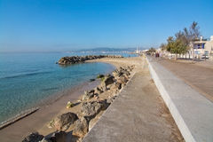 Molinar boardwalk and small rock pier Royalty Free Stock Images