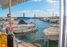 Molinar restaurant view. PALMA DE MALLORCA, BALEARIC ISLANDS, SPAIN - NOVEMBER 11, 2011: Molinar restaurant view of boat inlet on November 11, 2011 in Palma de Royalty Free Stock Photo