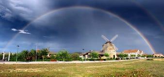 Molino de Aixerrota debajo bajo un arco iris imagenes de archivo