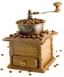 Molino de café de la antigüedad en el fondo blanco Foto de archivo libre de regalías