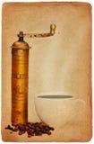 Molino de café y taza de café Fotografía de archivo libre de regalías