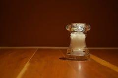 Molino de la sal en la tabla de madera Imagen de archivo libre de regalías