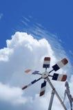 Molino de viento con el cielo nublado azul Fotografía de archivo libre de regalías