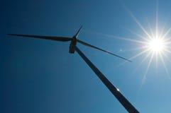 Molino de viento con el sol Foto de archivo libre de regalías