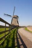 Molino de viento con la cerca Fotos de archivo libres de regalías