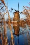 Molino de viento con la reflexión Foto de archivo libre de regalías