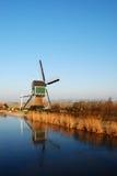 Molino de viento con la reflexión Imagen de archivo