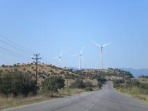 molino de viento en el camino en Macedonia Fotos de archivo libres de regalías