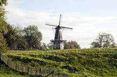 Molino de viento en el campo Fotos de archivo