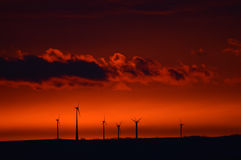 Molino de viento en la salida del sol temprana Imágenes de archivo libres de regalías