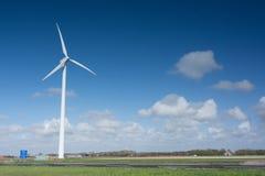 Molino de viento en los campos Imagen de archivo libre de regalías