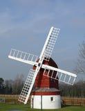 Molino de viento en paisaje Foto de archivo libre de regalías