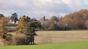 Molino de viento en una colina Foto de archivo libre de regalías
