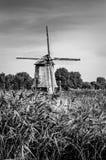 Molino de viento holandés blanco y negro Fotografía de archivo libre de regalías