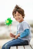 Molino de viento joven de la explotación agrícola del muchacho Imagen de archivo libre de regalías