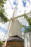 Molino de viento de madera blanco Imágenes de archivo libres de regalías