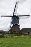 Molino de viento y violación Foto de archivo libre de regalías