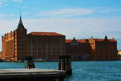 Molino Stucky in Venice, Italy. Molino Stucky historical building and blue water in Venice, Italy, Europe Royalty Free Stock Photo