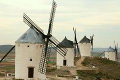 Molinoes de viento alineados fotografía de archivo libre de regalías