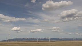 Molinoes de viento de lejos Fotos de archivo libres de regalías