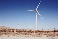 Molinoes de viento a distancia Foto de archivo
