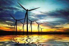 Molinoes de viento en el lago Imagen de archivo