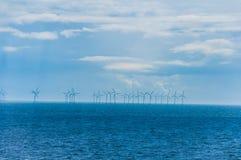 Molinoes de viento en el mar Imagenes de archivo