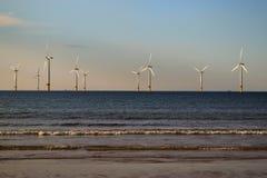 Molinoes de viento en el mar Imágenes de archivo libres de regalías