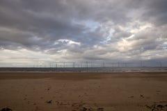 Molinoes de viento en el mar Foto de archivo