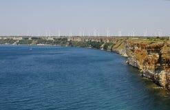 Molinoes de viento en la costa Imágenes de archivo libres de regalías