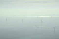 Molinoes de viento en la niebla Foto de archivo