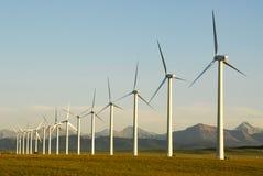 Molinoes de viento en la puesta del sol Foto de archivo libre de regalías