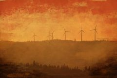 Molinoes de viento en la puesta del sol Obidos portugal imagen de archivo
