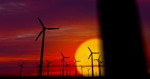Molinoes de viento en puesta del sol