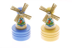Molinoes de viento miniatura en el fondo blanco Imagen de archivo libre de regalías