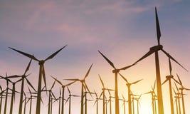 Molinoes de viento retroiluminados Imagen de archivo libre de regalías