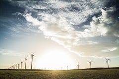 Molinoes de viento y puesta del sol Imagen de archivo libre de regalías
